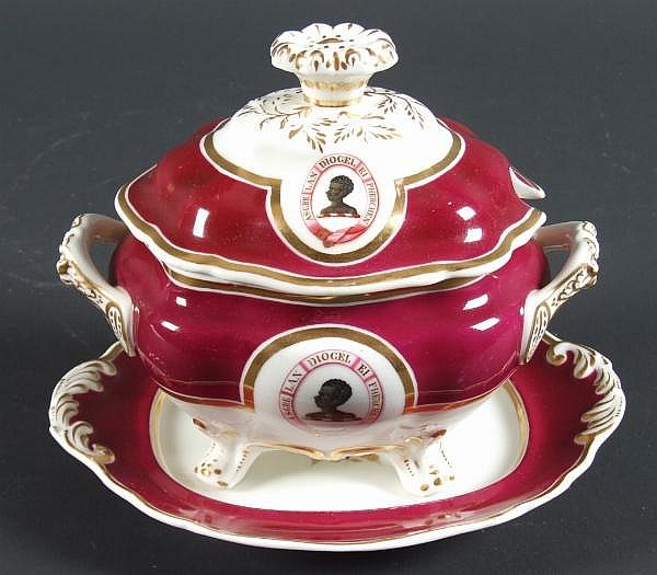 CHAMBERLAINS ANTISLAVERY TUREEN (1832) Chamberlains Worcester covered sauce tureen and underplate. Service created for the Hebert family with center decoration of black man surrounded by ancient Welsh motto ''A clear conscience is the best shield''
