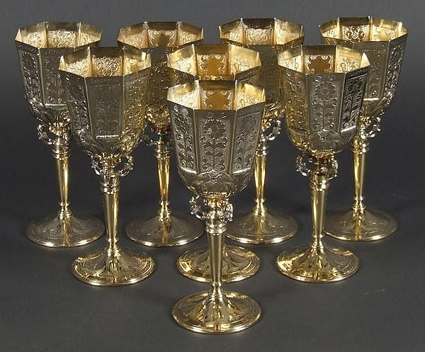 EIGHT SILVER VERMEIL GOBLETS. Eight silver vermeil commemorative goblets in the 17th c. style. Goblets copy 1683 originals by Johannes Copleston. These copies are hallmarked W & W London 1972. They are marked and numbered on the bottom: A Limited