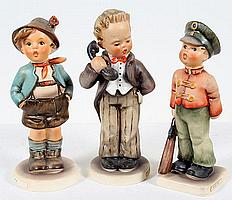 THREE HUMMEL FIGURINES. Lot includes: (1) #124 Hello, designed in 1939 by Arthur Moeller. Marked; TMK-3 small stylized bee, 6''H. (1) #95 Brother (Our Hero). Marked: TMK-6 missing bee mark. 5 3/4''H. (1) #332 Soldier boy designed in 1955 by Gerhard