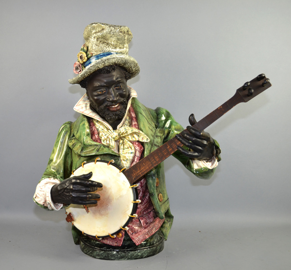 19th CENTURY AUSTRIAN MAJOLIC FIGURE OF A BLACK BANJO PLAYER