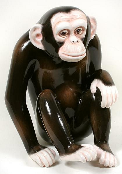 SERGIO BUSTAMANTE MONKEY SCULPTURE. Limited edition papier mache sculpture of seated monkey by Sergio Bustamante. Signed behind left ear ''Sergio Bustamante 21/100''. Size: 19 3/4''H, 14 1/2''W, 16''D. Condition: age appropriate wear.