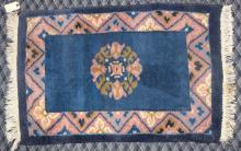 BLUE CHINESE THROW RUG, 2'11'' x 2'1''. Condition: Age appropriate wear. All items are sold as is.