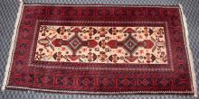 RED BALOUCH RUG, 6'5'' x 3'6''. Condition: Age appropriate wear. All items are sold as is.