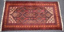 RED BALOUCH RUG, 6' x 3'2''. Condition: Age appropriate wear. All items are sold as is.