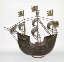 PRESSED STEEL MODEL OF A SPANISH GALLEON - Unsigned; Measures: 24''H x 27''W x 10''D - Condition: Age appropriate wear; All items sold as is.