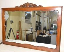 CARVED WOOD MIRROR, 32''H x 48''W, with basket of carved flowers on top. Condition: Age appropriate wear; All items sold as is.