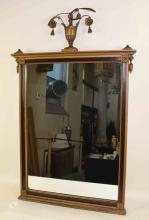 CLASSICAL MIRROR WITH URN WITH FLOWERS ON TOP. Condition: Breaks to side urns, 34''H x 24''W.