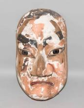 JAPANESE CARVED AND PAINTED MASK. 16''H x 8.5''L x 6''W. Condition: Much painted and gesso missing. Provenance: Phillips Collection, Butler, PA.