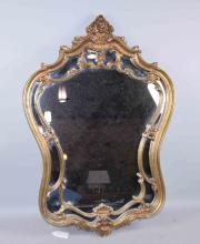 Baroque style mirror, 35''H x 24''W.  Condition: Age appropriate wear. All items sold as is.