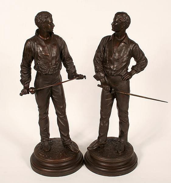 CHARLES MASSE FENCERS SCULPTURES. Two pot metal sculptures after Charles Masse (1855-1913) of Fencing Men. Bronze colored spelter on round bases. Marked: (in base) Ch. Masse. Size: 24''H, 8 5/8''Diam. base each. Condition: age appropriate wear, wear
