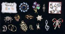 ASSORTED RHINESTONE COSTUME JEWELRY - Includes broaches and earrings - Condition: Age appropriatew wear; All items sold as is.