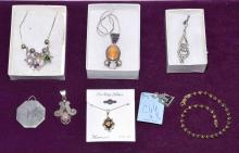 8pc ASSORTED STERLING COSTUME JEWELRY - Includes Pendants, chains and a locket; Total Weight 2.0 ozt - Condition: Age appropriate wear; All items sold as is.