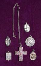 6pc STERLING SILVER RELIGOUS LOT - Includes enamel reliquary cross, greek reliquary St. Stylanos Pendant and (4) medals; Total Weight: 2.8 ozt - Condition: Age appropriate wear; All items sold as is.