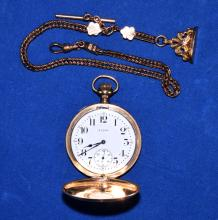 ELGIN 17 JEWEL GOLD FILLED POCKET WATCH AND FOB - Keystone watch case (J Boss 14k) warranted 25 years - Condition: Watch runs but crystal is missing; Age appropriate wear; All items sold as is.