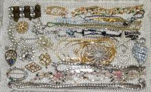 ASSORTED RHINESTONE JEWELRY - Includes necklaces, pins and brooches - Condition: Age appropriate wear; All items sold as is.