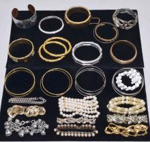 30+ ASSORTED BRACELETS - Includes cuff, bangle, and beaded - Condition: Age appropriate wear; All items sold as is.