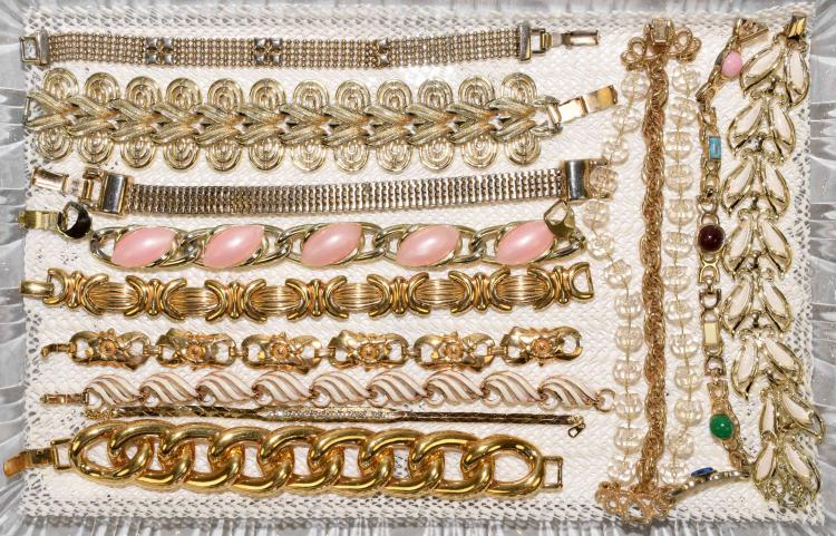 (12) GOLD TONE BRACELETS - Designers include: Coro, Trifari, Napier, Sarah Coventry - Condition: Age appropriate wear; All items sold as is.