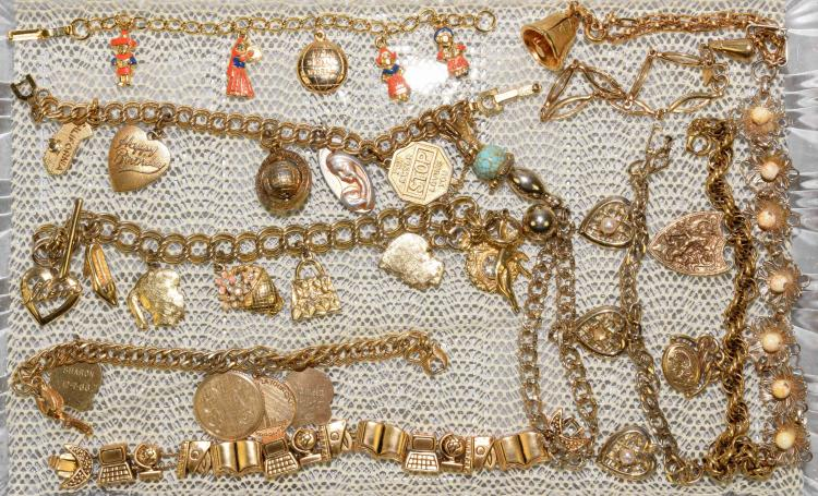 (11) ASSORTED GOLD TONE CHARM BRACELETS - Designers include: Monet, Sarah Coventry, Germany, It's a Small World Disney - Condition: Age appropriate wear; All items sold as is.
