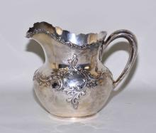 1894 STERLING SILVER 3 PINT WATER PITCHER # 214 - Measures: 6.5''H x 8''W x 5.5''D; Total weight: 17.13 ozt - Condition: Age appropriate wear; All items sold as is.