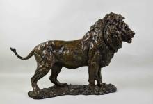 KENNETH BUNN (AMERICAN, b. 1938) BRONZE ''SERENGETI LION'' - Signed ''Bunn 2000 23/25''; Measures: 19''H x 28''W x 9''D; Provenance: Purchased from Kenneth Bunn in 2011 for $11,200; From the Estate Collection of Robert B Fay Jr.
