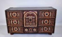 ALFONSO MARINA ''CADIZ CABINET'' - Spanish inspired, 7-drawer cabinet with hand painted front, hand hammered iron accents and handles, resting on bunn feet; paper label on reverse; Measures: 21''H x 36.25''W x 13.75''D; Provenance: From the Estate Collection of Robert B Fay Jr.