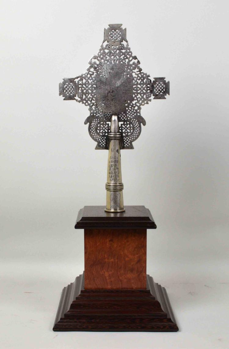 (1) ETHIOPIAN COPTIC SILVERED CROSS - Measures: With base 22''H x 9''W x 9''D, cross 14''H x 8.25''W; Provenance: From the Estate Collection of Robert B Fay Jr.