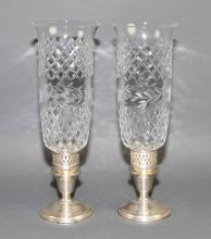 VINTAGE STERLING HURRICANE LAMPS - Etched glass shades with Sterling bases; Marked International Sterling; Measures: 12''H x 4''W - Condition: Age appropriate wear; All items sold as is.