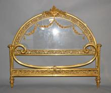 ANTIQUE FRENCH VICTORIAN SOLD BRASS AND BEVELED GLASS BED - Turn of the century; Solid brass ormalu, beveled plate glass inserted in headboard; Headboard: 54''H x 59.5''W, Footboard 30''H x 61.5''W - Condition: Excellent condition; All items sold as is.