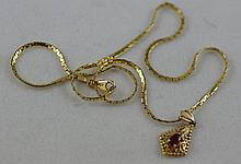 14ct gold chain with 9ct gold gemset pendant