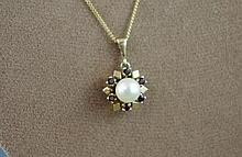 Pearl and garnet pendant on 9ct yellow gold chain,