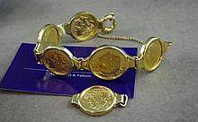 18ct gold bracelet with 6 gold coins including two