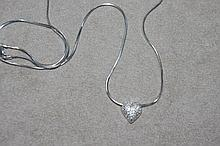Diamond set platinum heart shaped locket on a