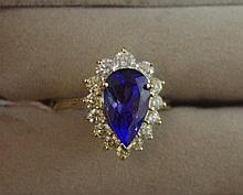 14ct yellow gold diamond & pear cut tanzanite ring