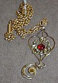 Edwardian 9ct gold pendant with 14 ct gold chain.