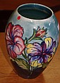 Moorcroft hibiscus vase signed and paper label to