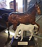 Two Beswick horse figurines one with repair to leg