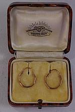 Pair of 9ct gold sleeper earrings stamped 9ct