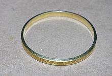 14ct yellow gold bangle Total weight approx 12.9