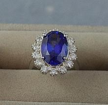 14ct white gold, diamond and tanzanite ring oval
