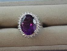 Silver and oval amethyst ring