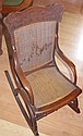 Antique child's rocking chair with cane seat