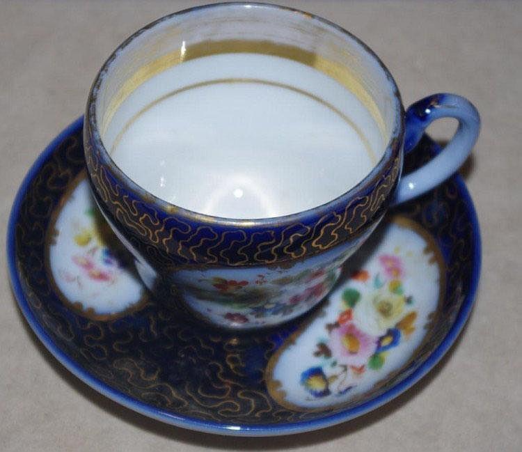Antique handpainted porcelain cup & saucer