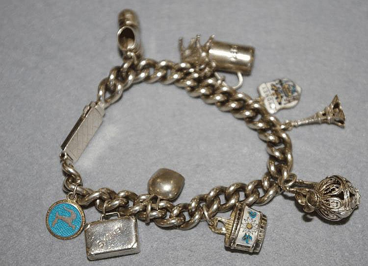 Sterling silver charm bracelet includes suitcase