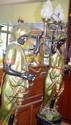 Pair of vintage blackamoor figures each holding an