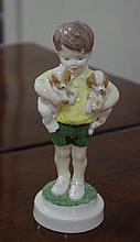 Royal Worcester figurine of boy and two puppies,