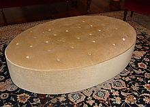 Antique poof on casters in beige