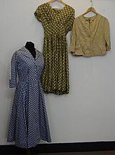 Two polka dot dresses with a beige silk jacket,