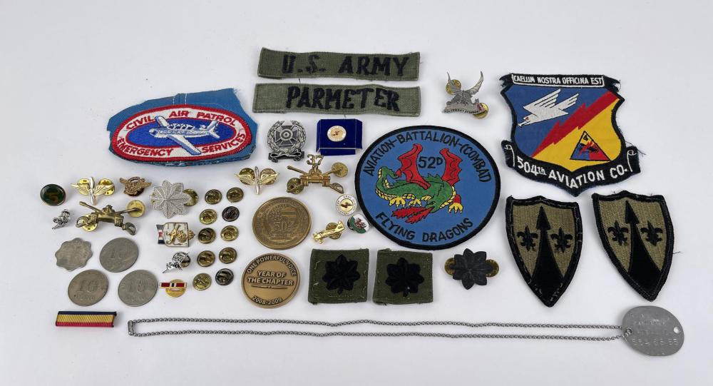 NAMED COLLECTION OF VIETNAM WAR PATCHES PINS