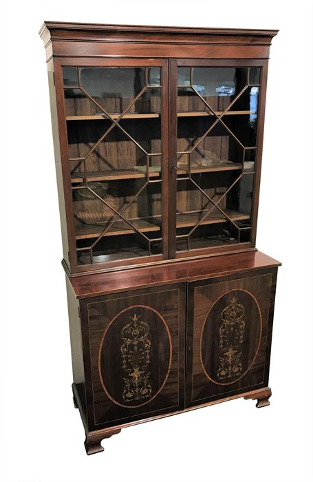 A 19th century mahogany glazed bookcase the top with a pair of astragal glazed doors enclosing