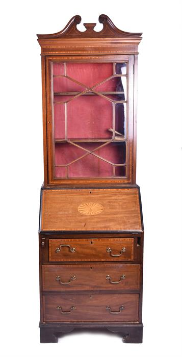 A small inlaid Edwardian bureau bookcase The base accommodating three drawers below a cross-banded